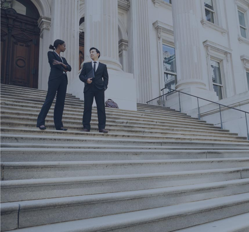 lawyers talking on the courthouse steps | Luis Guerra Personal Injury Trial Attorneys | Phoenix, Arizona