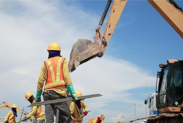 workers in construction zone | Luis Guerra Personal Injury Trial Attorneys | Phoenix, Arizona