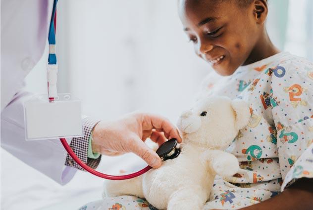 doctor pretend examining little boy's stuffed toy | Luis Guerra Personal Injury Trial Attorneys | Phoenix, Arizona